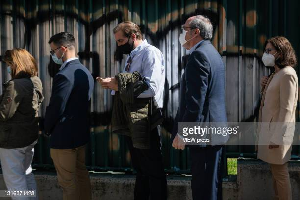 The PSOE candidate Angel Gabilondo waits in line to cast his vote, at the gates of the Joaquin Turia electoral college, where he is going to cast his...