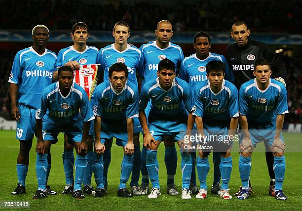 The PSV Eindhoven team pose for the cameras prior to kickoff during the UEFA Champions League round of sixteen second leg match between Arsenal and...