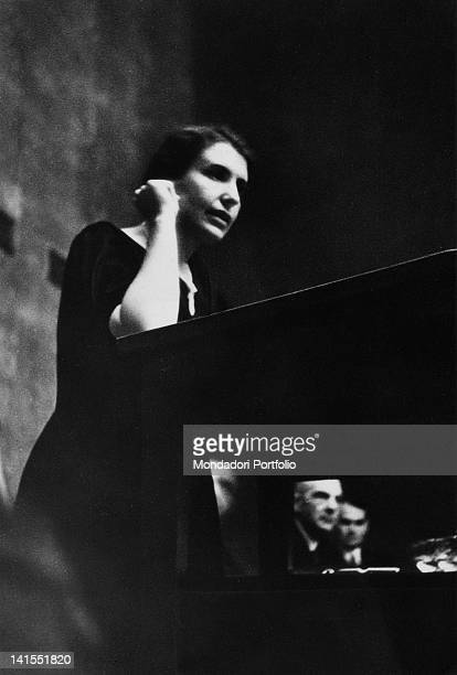 The psychoanalyst Anna Freud daughter of the founder of psychoanalysis Sigmund Freud speaking from the stage at a congress. Lucerne, 1934