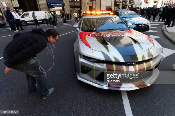 The public admires race cars as NASCAR drivers take over Center City Philadelphia PA streets on May 9 2017 in a promotion event for the upcoming June...