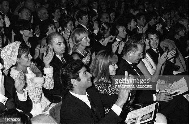 The public Dalida Gerard Oury Michele Morgan JeanClaude Brialy at the Olympia in Paris France on August 17 1965