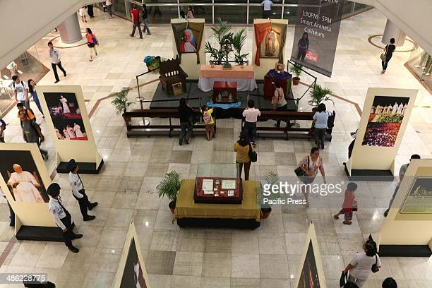 The public exhibition and veneration of the relics and the photo reproduction of Blessed John Paul II at the activity area of Gateway Mall in Araneta...