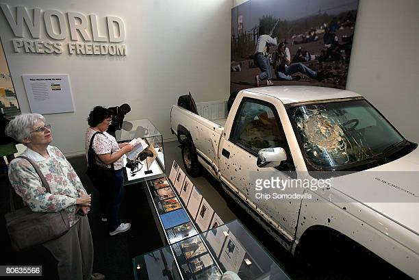 The public gets its first look at the bullet- and shrapnel-riddled truck used by Time Magazine photographers and reporters during the war in the...