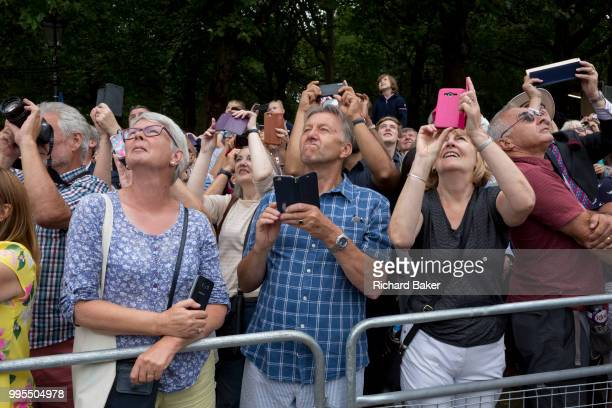 The public look upwards on the 100th anniversary of the Royal Air Force and during a flypast of 100 aircraft formations representing Britain's air...