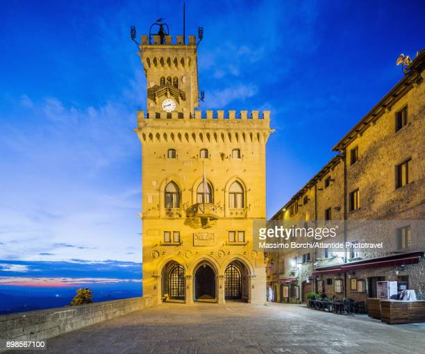 the public palace (town hall) at twilight - republic of san marino stock pictures, royalty-free photos & images