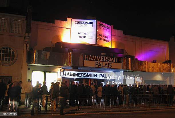 The public queue outside the Hammersmith Palais as it plays host to The Fall on April 1 2007 in London This was the last scheduled concert at the...