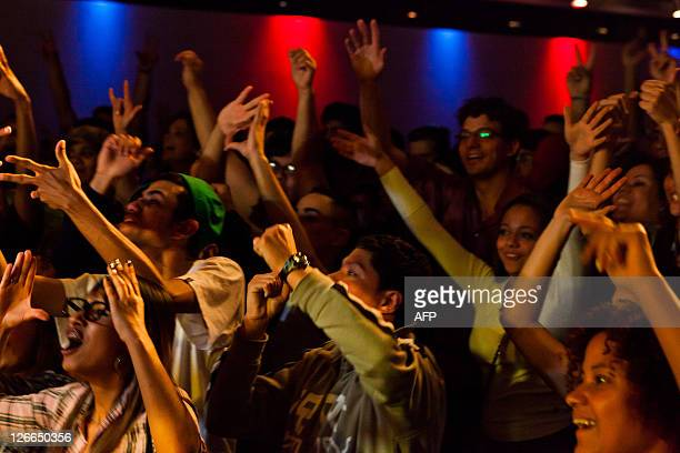 The public show their joy as Dutch hearingimpaired performer Serhat Agacan dances onstage employing gestural language during the Sencity event held...