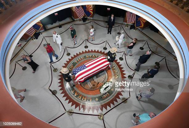 The public view the casket of the late Sen John McCain as his body lies in state at the Arizona State Capitol Rotunda on August 29 2018 in Phoenix...