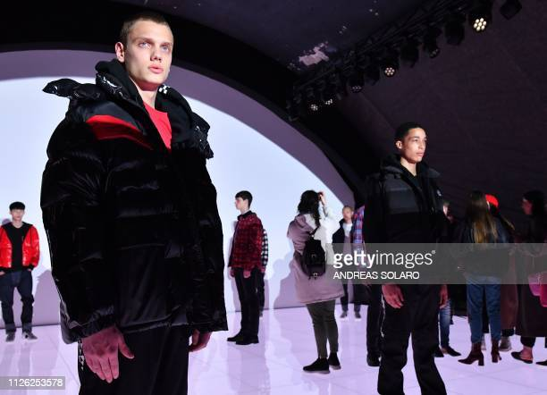 The public walks among models presenting creations during the Moncler women's Fall/Winter 2019/2020 collection fashion show on February 20 2019 in...