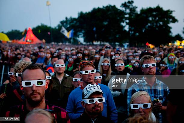 The public wears 3D glasses during a concert of German band Kraftwerk on July 7 2013 during the Roskilde festival in Rokslide AFP PHOTO / SCANPIX...