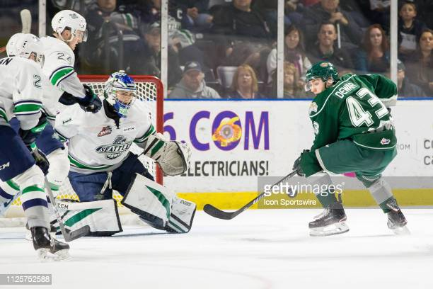 The puck bounces away from Everett Silvertips center Connor Dewar before he can get a shot on Seattle Thunderbirds goaltender Roddy Ross during a...