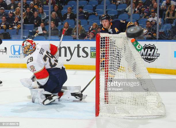 The puck deflects away from Harri Sateri of the Florida Panthers and Jack Eichel of the Buffalo Sabres during an NHL game on February 1 2018 at...