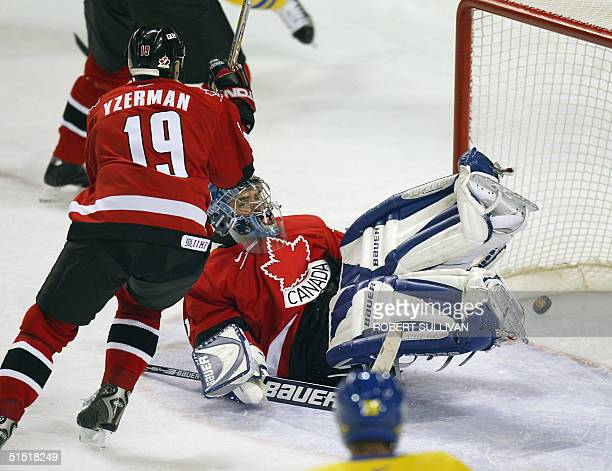 The puck eludes Canadian goalkeeper Curtis Joseph for a second round goal by Sweden during their Men's Ice Hockey match at the XIX Winter Olympics 15...