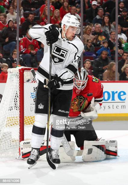 The puck flys toward Tanner Pearson of the Los Angeles Kings and goalie Anton Forsberg of the Chicago Blackhawks in the first period at the United...