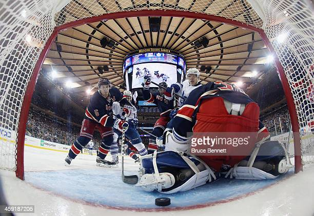 The puck gets behind Cam Talbot of the New York Rangers but doesn't enter the net during the third period against the Toronto Maple Leafs at Madison...