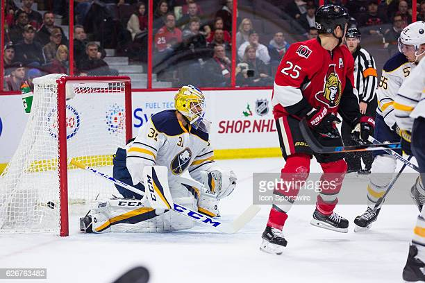 The puck gets by Buffalo Sabres Goalie Anders Nilsson the goal was disallowed due to goaltender interference during second period National Hockey...