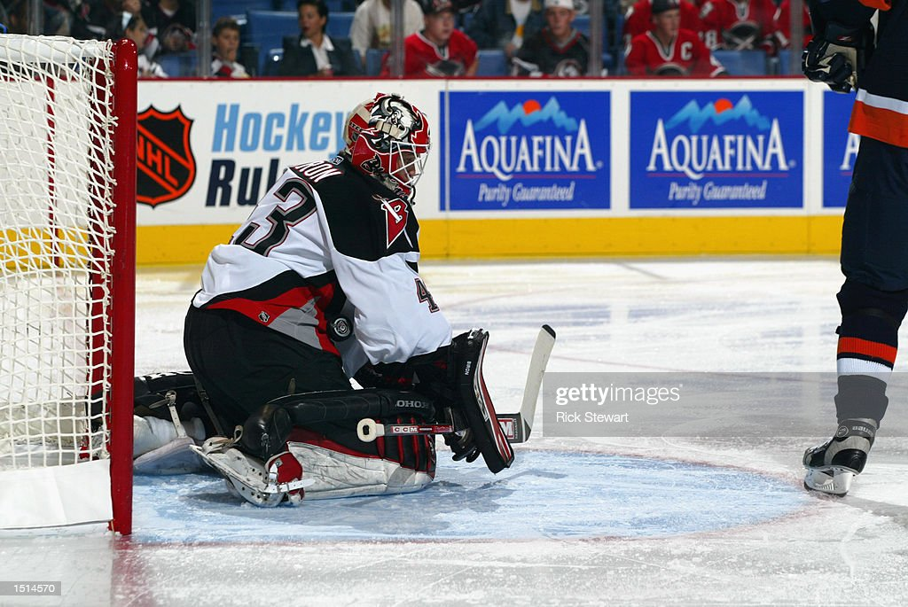 The puck gets by goaltender Martin Biron #43 of the Buffalo Sabres during the NHL game against the New York Islanders on October 10, 2002 at HSBC Arena in Buffalo, New York. The Sabres defeated the Islanders 5-1.