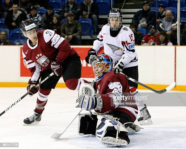 The puck gets by Janis Kalnins of Team Latvia during the 2010 IIHF World Junior Championship Tournament Relegation game against Team Austria on...