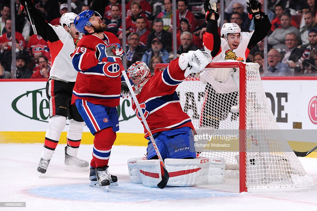 The puck gets past Carey Price #31 of the Montreal Canadiens on a shot by Milan Michalek #9 of the Ottawa Senators (not pictured) in Game One of the Eastern Conference Quarterfinals during the 2015 NHL Stanley Cup Playoffs at the Bell Centre on April 15, 2015 in Montreal, Quebec, Canada.