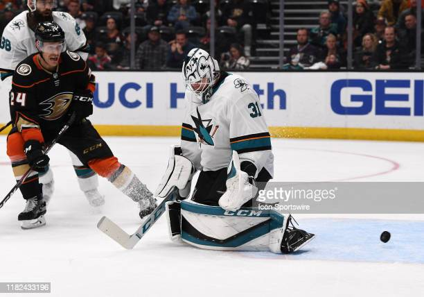 The puck goes by San Jose Sharks goalie Martin Jones for a goal during the third period of a game against the Anaheim Ducks played on November 14...