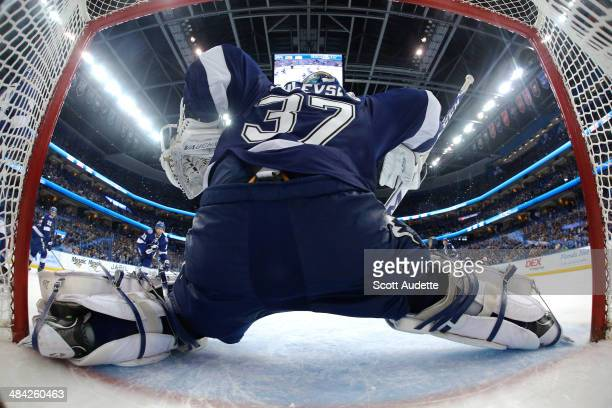 The puck goes over the shoulder of goalie Kristers Gudlevskis of the Tampa Bay Lightning for a goal for the Columbus Blue Jackets during the third...