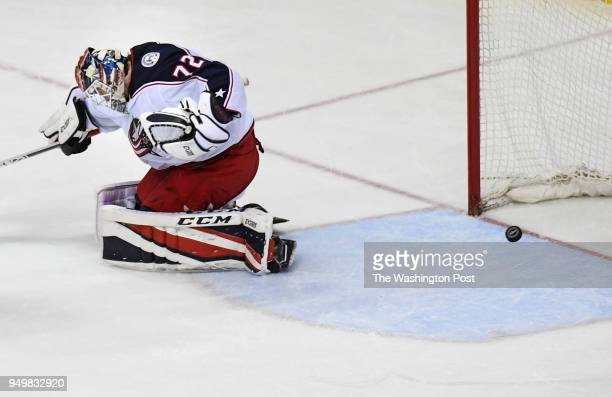 WASHINGTON DC APRIL The puck goes past Columbus Blue Jackets goaltender Sergei Bobrovsky for the game winner scored by Washington Capitals center...