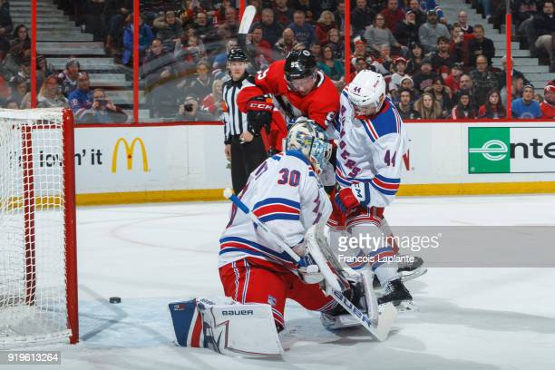 The puck goes wide as Matt Duchene of the Ottawa Senators battles for a position against Neal Pionk of New York Rangers defends and Henrik Lundqvist...