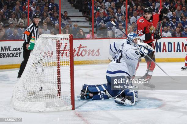 The puck hits the back of the net behind Garret Sparks of the Toronto Maple Leafs on a third period goal by Cody Ceci of the Ottawa Senators as Colin...