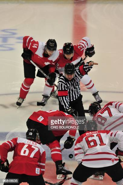 The puck is dropped during the face off at the Men's preliminary Ice Hockey match Switzerland against Canada at the XXI Winter Olympic games in...