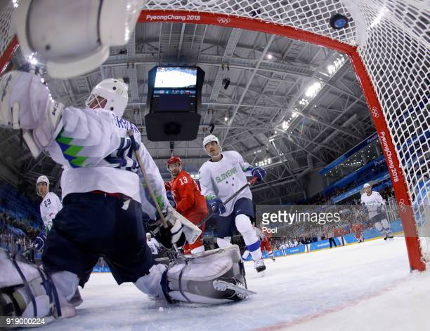 The puck shot by Kirill Kaprizov of Russia flies into the net for a goal during the Men's Ice Hockey Preliminary Round Group B game between Russia...