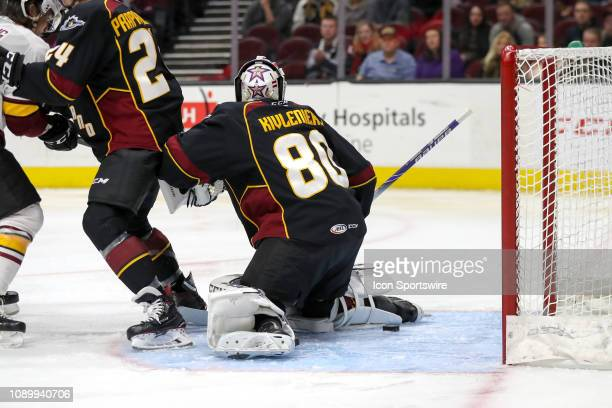 The puck sits behind Cleveland Monsters goalie Matiss Kivlenieks after he made a save during the first period of the American Hockey League game...