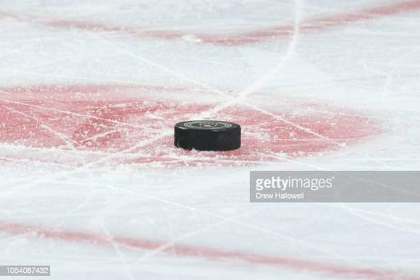 The puck sits on the ice during the game between the San Jose Sharks and Philadelphia Flyers at the Wells Fargo Center on October 9 2018 in...