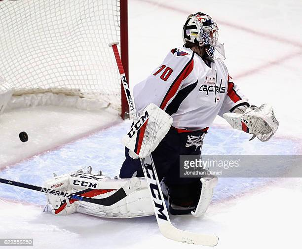 the puck slips past Braden Holtby of the Washington Capitals on a goal by Brian Campbell of the Chicago Blackhawks at the United Center on November...