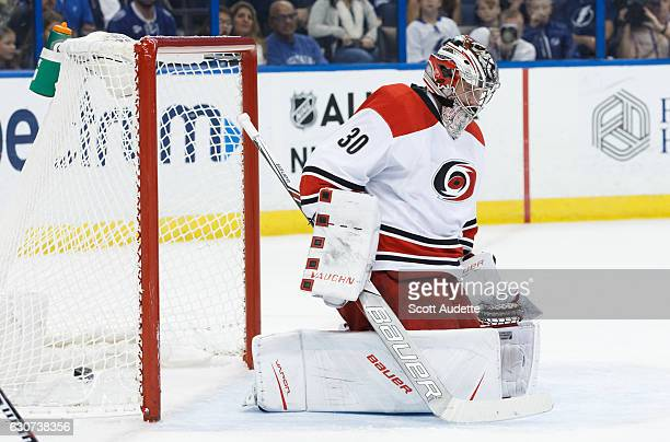 The puck sneaks by goalie Cam Ward of the Carolina Hurricanes for a goal for the Tampa Bay Lightning during first period at Amalie Arena on December...