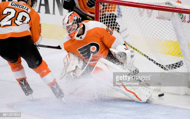 The puck sneaks by Philadelphia Flyers Goalie Brian Elliott for a Maple Leafs goal in the first period during the game between the Toronto Maple...