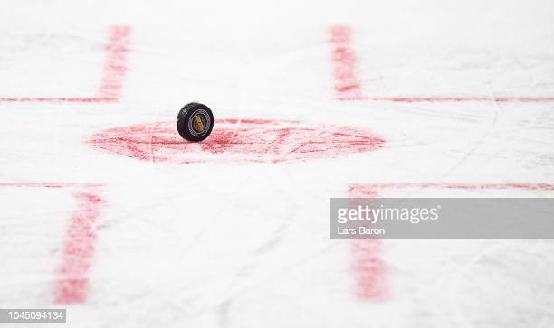 The puck with the logo is seen on the ice duirng the NHL Global Series Challenge game between Edmonton Oilers and Kolner Haie at Lanxess Arena on...