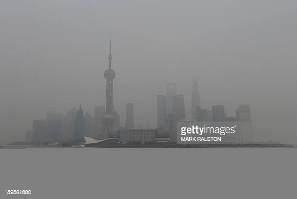 The Pudong business district is shrouded by heavy air pollution in Shanghai on January 16 2013 Several days of hazardous air quality across large...