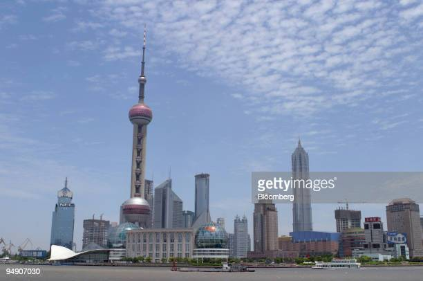 The Pudong business district skyline is pictured from the Bund in Shanghai China Tuesday June 1 2004