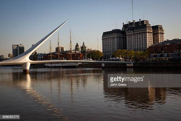 The Puente da la Mujer and the Museo Fragata Sarmiento is seen at sunset in the Puerto Madero neighborhood in Buenos Aires Argentina September 17 2015