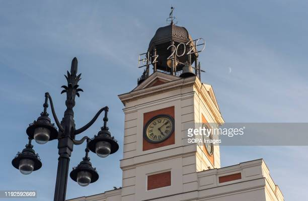 The Puerta del Sol clock displays the enter of the year with a 2020 sign in Madrid, Spain.