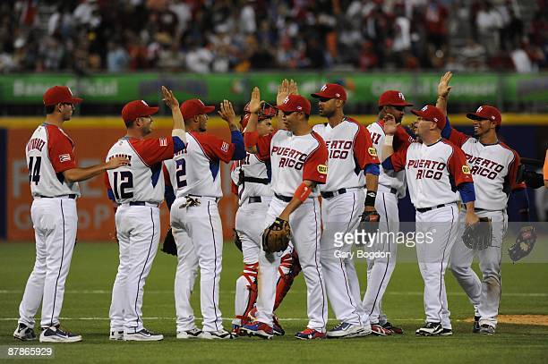 The Puerto Rico team celebrates after their win against Panama during the Pool D, game two between the Puerto Rico and Panama during the the first...