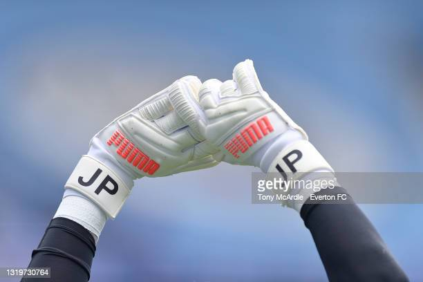The Puma Goalkeeper gloves of Jordan Pickford of Everton as he warms up before the Premier League match between Manchester City and Everton at the...
