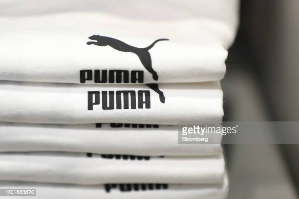 The Puma logo sits white t-shirts inside the Puma SE concept store in Herzogenaurach, Germany, on Wednesday, Feb. 19, 2020. Puma soared to a record...