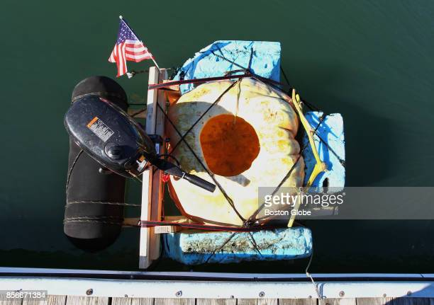 The pumpkin boat belonging to Christian Ilsley is pictured in Boston Harbor on Oct 1 2017 It was built from his giant pumpkin scrap wood 100 feet of...