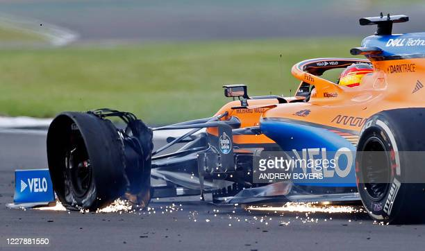 The punctured tyre of McLaren's Spanish driver Carlos Sainz Jr is picture as he nears the finish of the Formula One British Grand Prix at the...