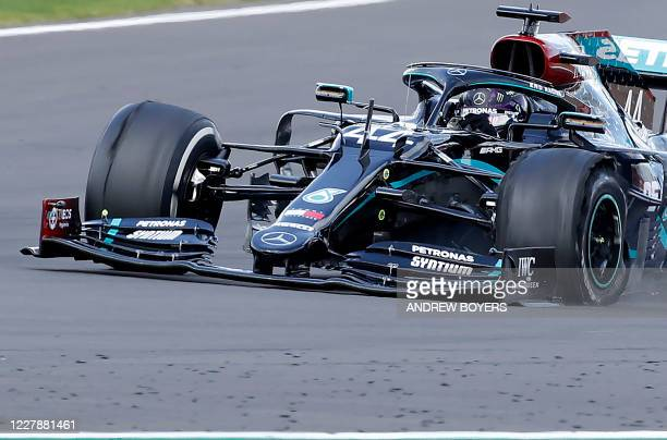The punctured tyre of Mercedes' British driver Lewis Hamilton punctures is pictured as he goes on to win the Formula One British Grand Prix at the...
