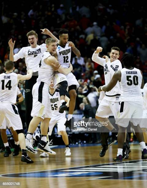 The Purdue Boilermakers celebrate after beating the Iowa State Cyclones 8076 during the second round of the 2017 NCAA Tournament at BMO Harris...