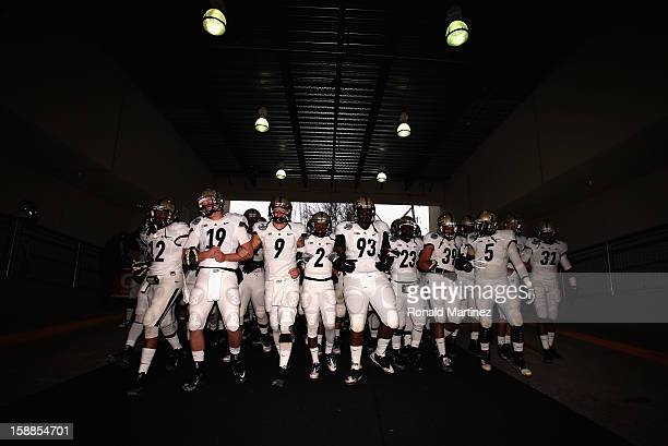 The Purdue Boilermakers walk to the field before play against the Oklahoma State Cowboys during the Heart of Dallas Bowl at Cotton Bowl on January 1,...