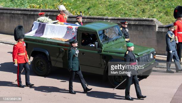 The purpose built Land Rover carrying Prince Philip, Duke of Edinburgh's coffin is flanked by pallbearers from the Royal Marines and other regiments...