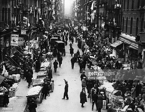 The pushcart market in the East Side Ghetto of New York's Jewish Quarter is a hive of activity